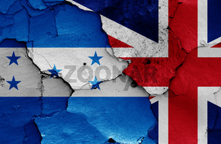 flags of Honduras and UK painted on cracked wall