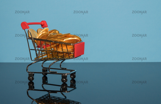 Sale mockup or background with shopping cart filled with gold coins