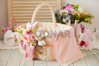 Wicker basket decorated with flowers and laces