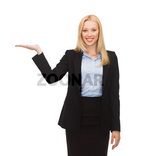 man showing something imaginary on her hand