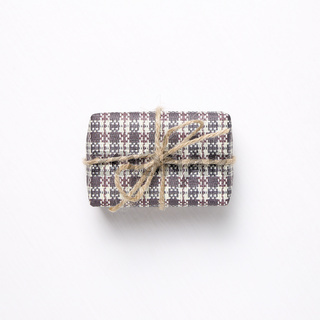 Purple check pattern gift box isolated on white background