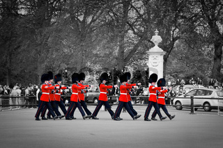 LONDON - MAY 17: British Royal guards march and perform the Changing of the Guard in Buckingham Palace