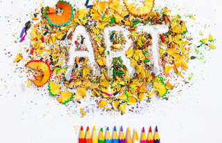 ART word on the background of colored shavings and pencils