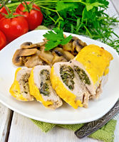 Roll chicken with champignons and cheese on board