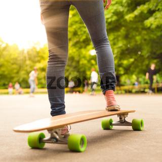 Girl practicing urban long board riding.
