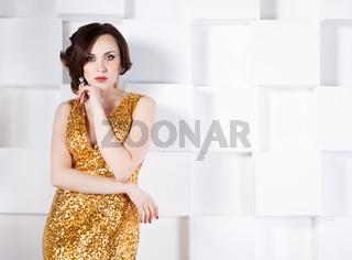 Superstar woman wearing golden shining dress
