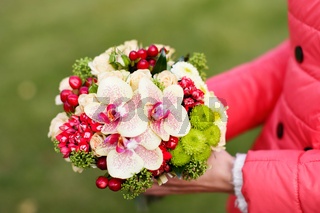 Stylish rich bouquet with red berries