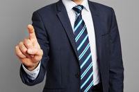 Hand vom Geschäftsmann mit Zeigefinger