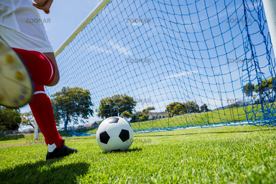 Football player scoring a goal