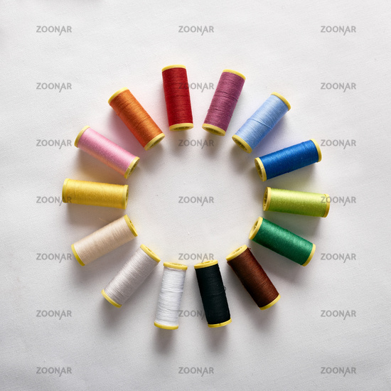 Spools of thread in circle