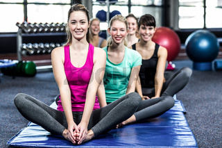 Fit smiling group doing yoga