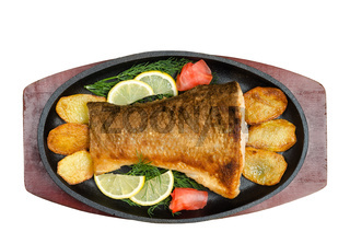 Fried fish in the pan, on a white background.