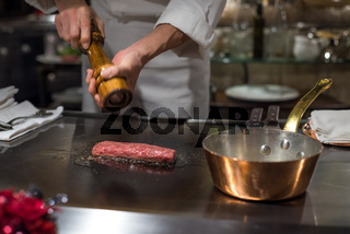 Chef cooking wagyu beef in Japanese teppanyaki restaurant, Tokyo, very shallow focus