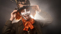 Portrait of smiling young man similitude Hatter
