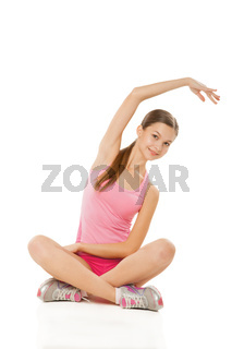 Young sporty woman doing exercises over white