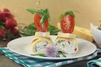 stuffed cheese crepe rolls with tomatoes
