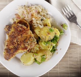 Schnitzel With Potato Salad and Sauerkraut
