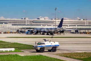 Police vehicle patrols airport in Munich.