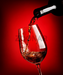 Red wine on red background