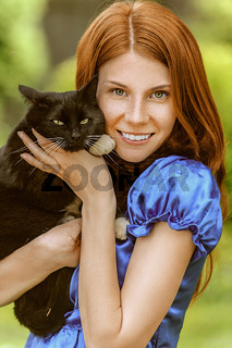 young woman with black cat