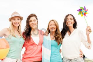 smiling girls having fun on the beach