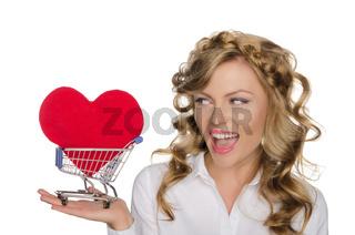beautiful woman with heart in shopping cart