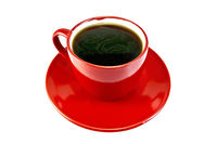 Coffee in red cup on saucer