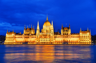 Hungarian Parliament Building on the bank of the Danube in Budapest by night