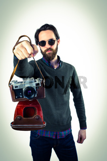 Hipster using his vintage camera