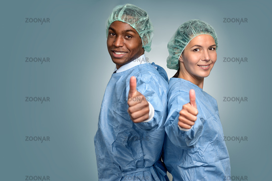 African doctor and nurse giving thumbs up