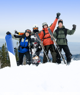 group of snowboarders and skiers on mountain