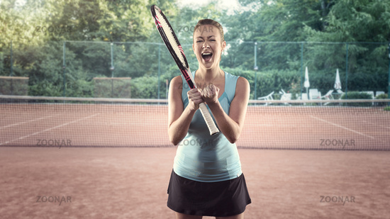 Athletic Woman with Tennis Racket Celebrating