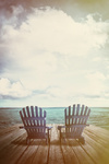 Adirondack chairs on dock with vintage textures and feel