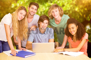Composite image of college students using laptop in library