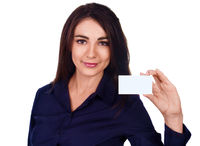 Young businesswoman handing a blank business card , isolated over white