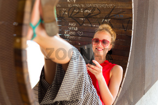 Young cheerful lady taking selfie.
