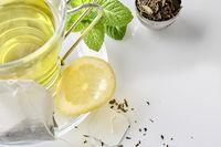 Green tea with mint and lemon with teabag closeup top