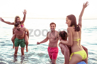 Happy friends having fun in the water