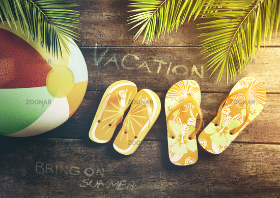 Summer sandals with beach ball on wood background