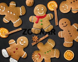 Many gingerbread men on a blackboard
