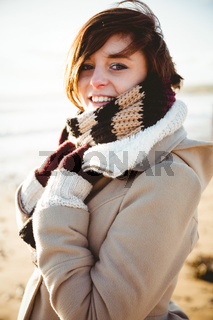 Happy pretty brunette looking at camera