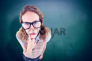 Composite image of geeky hipster woman thinking with hand on chin