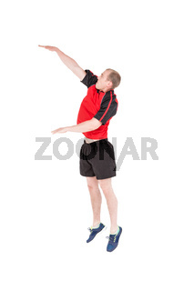 Sportsman hitting volleyball