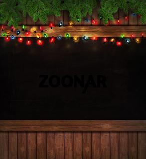 Christmas lights on wooden blackboard