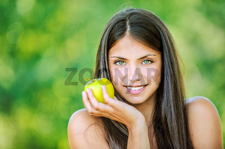 woman with bare shoulders holding an apple