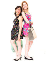 Happy Smiling Shopping Women with Bags. Isolated Over White Background.