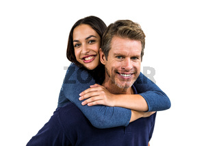Portrait of cheerful man carrying girlfriend on back