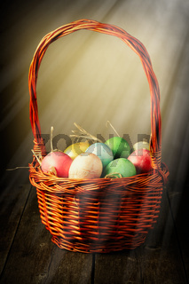 Colored easter eggs in basket