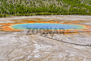 Visitors exploring the amazing colors of the Grand Prismatic Spring