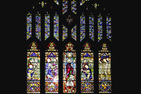 Colorful glass window with art designs in a church
